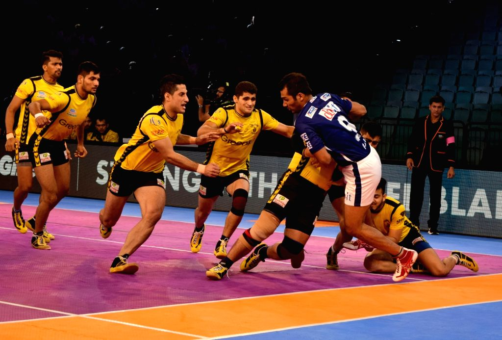 Players in action during a Pro Kabaddi League 2017 match between Dabang Delhi and Telugu Titans at the Thyagraj Sports Complex in New Delhi on Sept 28, 2017.