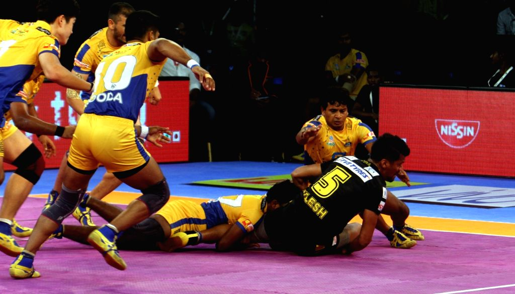 Players in action during a Pro Kabaddi League 2017 match between Tamil Thalaivas and Telugu Titans in Chennai, on Oct 3, 2017.