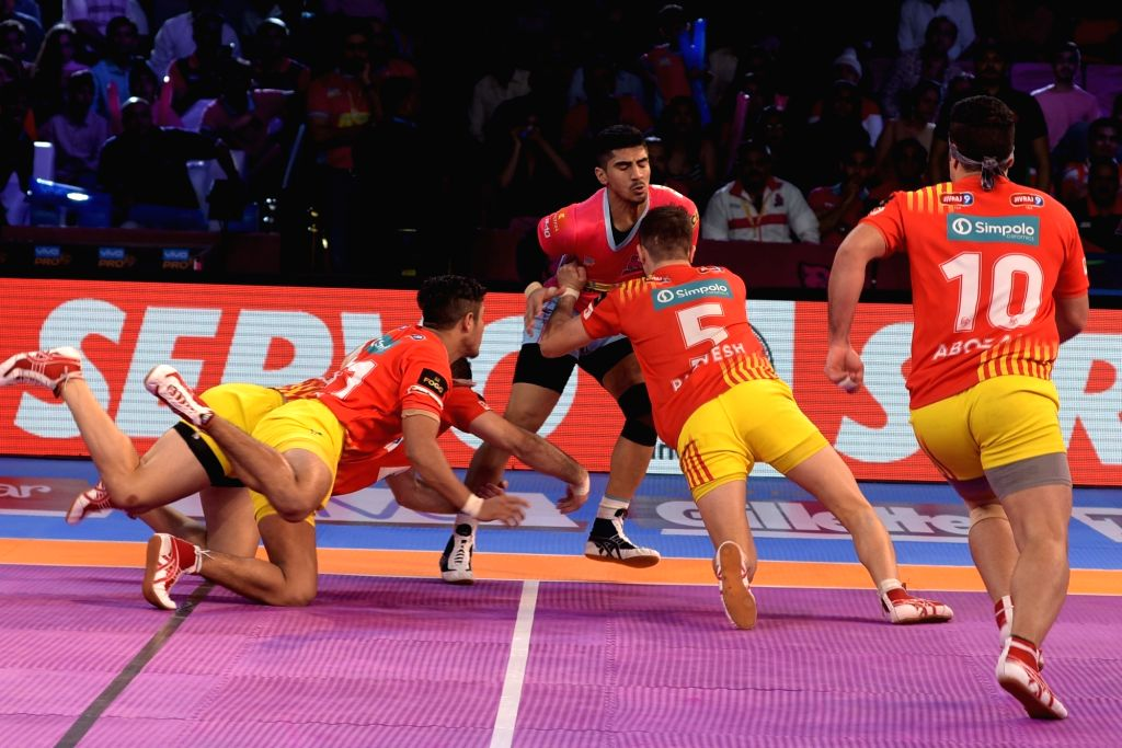 Players in action during a Pro Kabaddi League match between Jaipur Pink Panthers and Gujarat Fortunegiants at Sawai Mansingh Stadium in Jaipur on Oct 6, 2017.