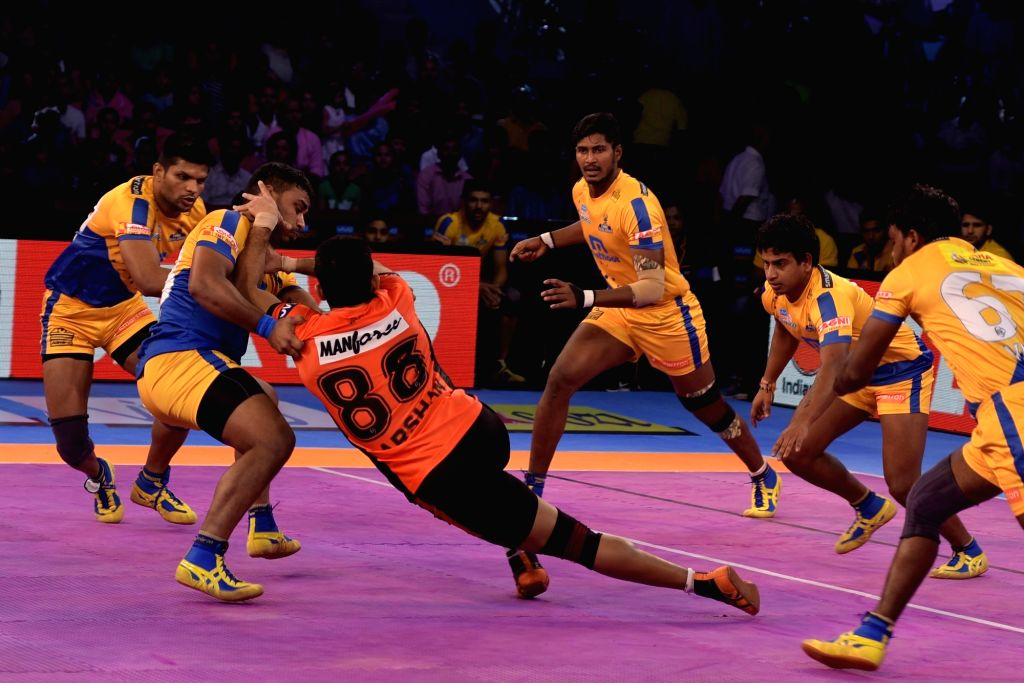 Players in action during a Pro Kabaddi League match between U Mumba and Tamil Thalaivas in Jaipur on Oct 10, 2017.