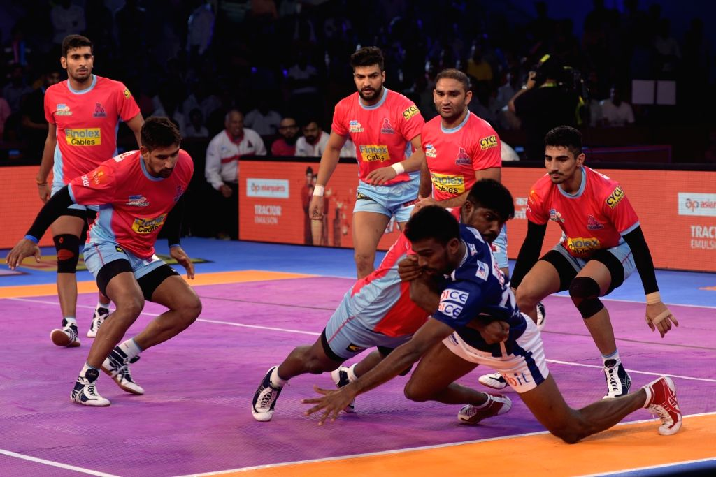 Players in action during a Pro Kabaddi League match between Jaipur Pink Panthers and Dabang Delhi K.C. in Jaipur on Oct 10, 2017.