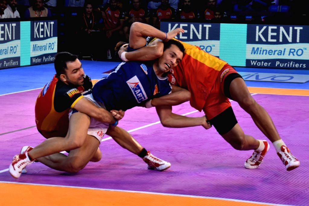Players in action during a Pro Kabaddi League match between Dabang Delhi K.C. and Bengaluru Bulls in Jaipur on Oct 11, 2017.