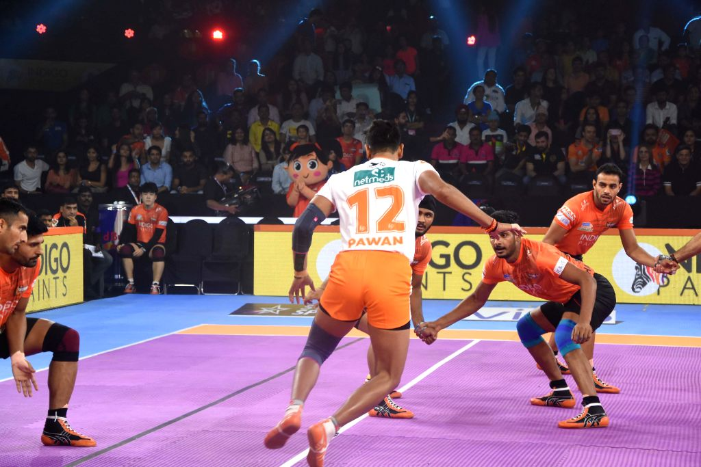 Players in action during a Pro Kabaddi League Season 7 match between U Mumba and Puneri Paltan at National Sports Club of India (NSCI) in Mumbai on July 27, 2019.