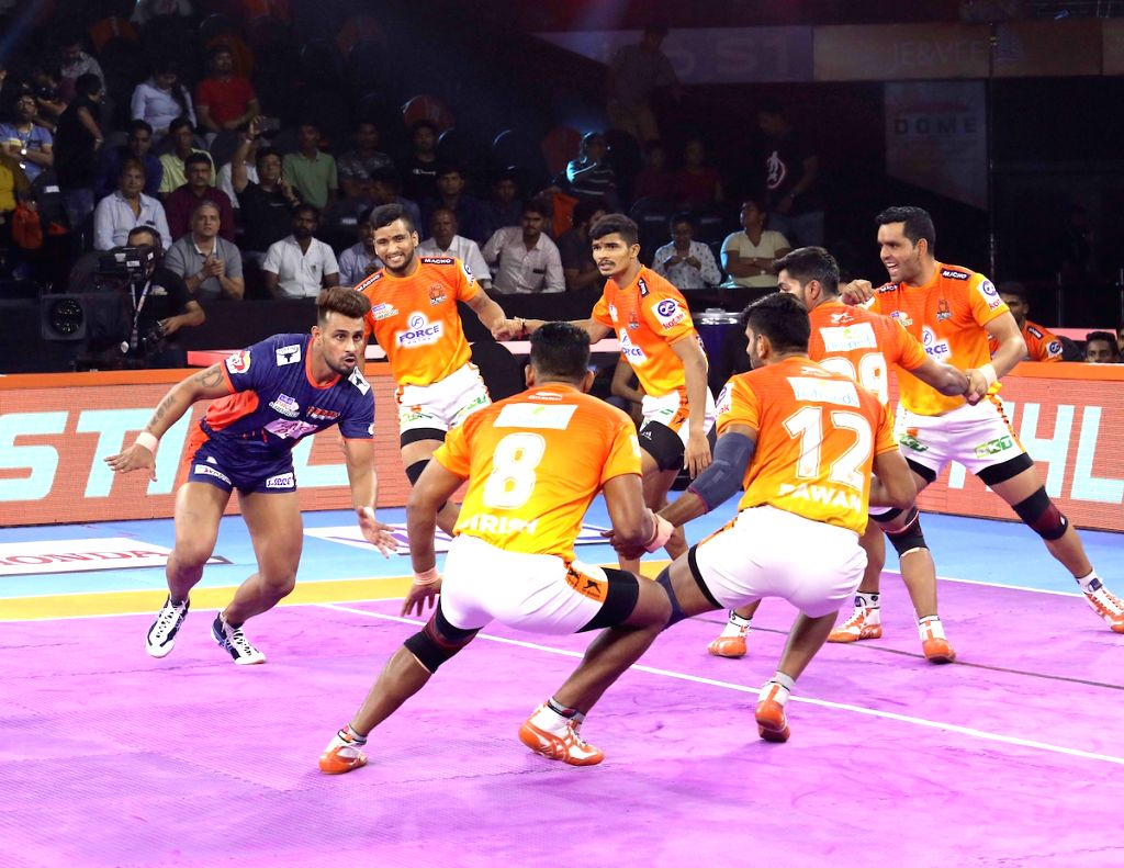 Players in action during a Pro Kabaddi League Season 7 match between Bengal Warriors and Puneri Paltan at National Sports Club of India (NSCI) in Mumbai on July 29, 2019.