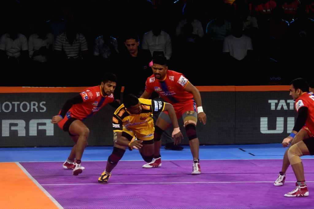 Players in action during a Pro Kabaddi Season 7 match between Gujarat FortuneGiants and Dabang Delhi K.C. at National Sports Club of India in Mumbai on Aug 2, 2019.