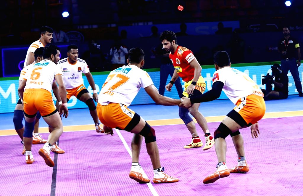 Players in action during a Pro Kabaddi Season 7 match between Gujarat Fortune Giants and Puneri Paltan s in Patna on Aug 5, 2019.