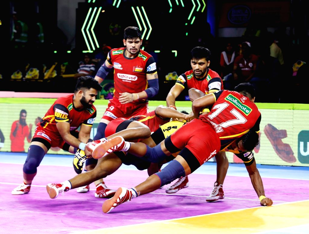 Players in action during a Pro Kabaddi Season 7 match between Telugu Titans and Bengaluru Bulls at Patliputra Sports Complex in Patna on Aug 8, 2019.