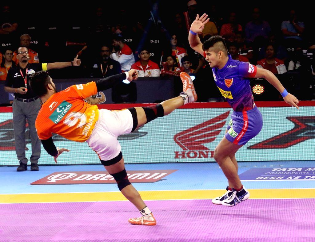 Players in action during a Pro Kabaddi Season 7 match between Puneri Paltan and Dabang Delhi at EKA Arena in Ahmedabad on Aug 10, 2019.