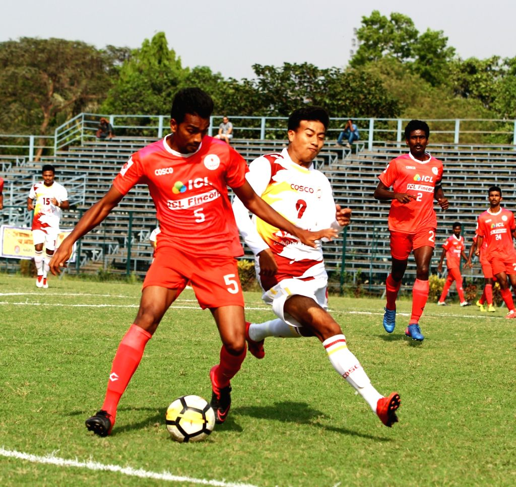 Players in action during a Santosh Trophy match between West Bengal and Kerala at Rabindra Sarobar stadium in Kolkata on March 27, 2018.
