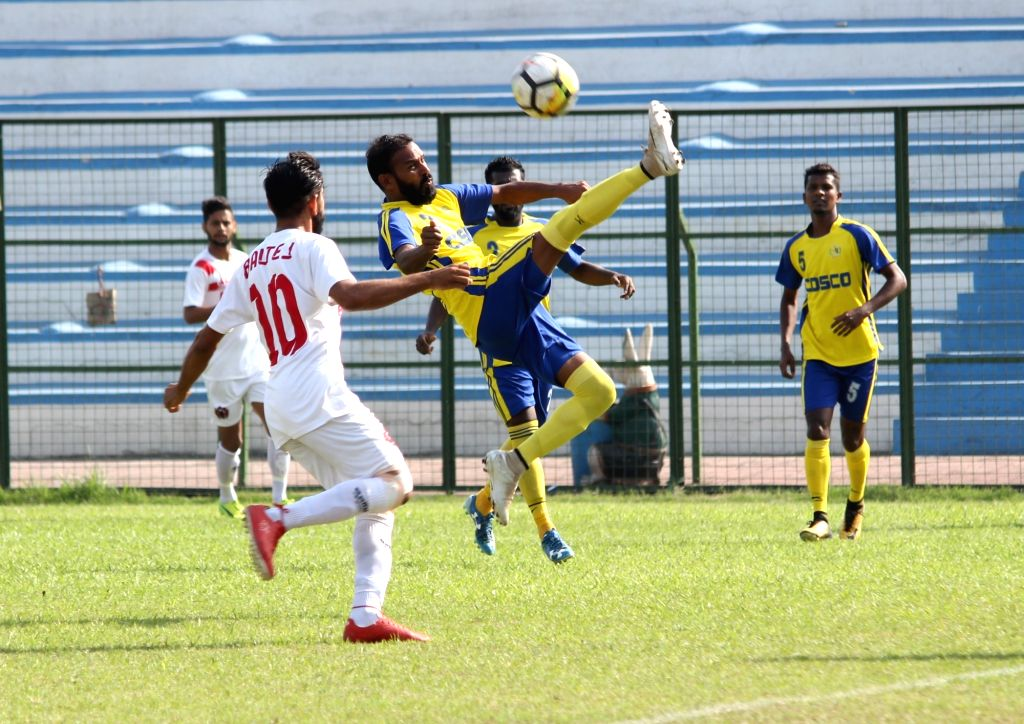 Players in action during a Santosh Trophy match between Goa and Punjab at Sailen Manna Stadium in Howrah on March 28, 2018.
