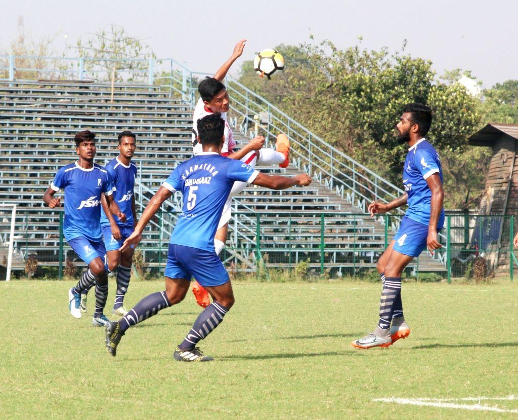 Players in action during a Santosh Trophy match between Mizoram and Karnataka at Rabindra Sarobar stadium in Kolkata on March 28, 2018.