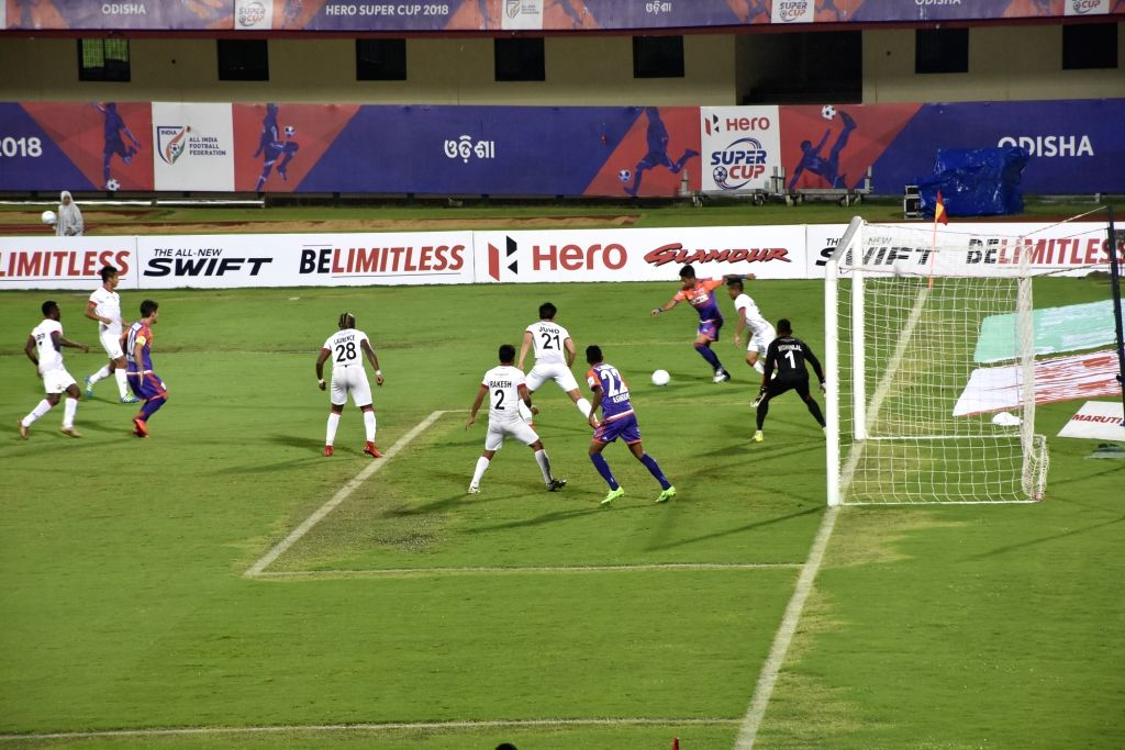Players in action during a Super Cup match between FC Pune City and Shillong Lajong FC at Kalinga Stadium in Bhubaneswar, on April 4, 2018. (Photo : IANS)