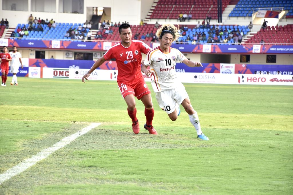 Players in action during a Super Cup quarterfinal match between Aizawl FC and East Bengal FC, in Bhubaneswar on April 8, 2018.