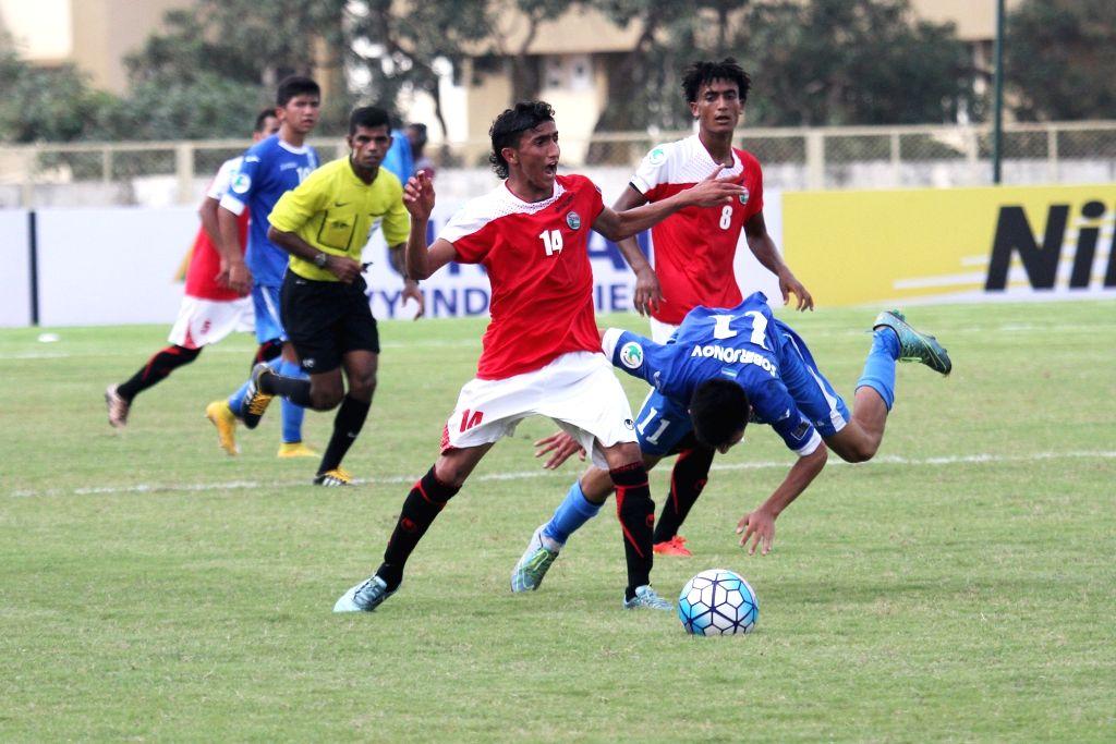Players in action during AFC U-16 Championship India 2016 between Yemen and Uzbekistan at Bambolim Stadium on Sept 20, 2016. Uzbekistan won.