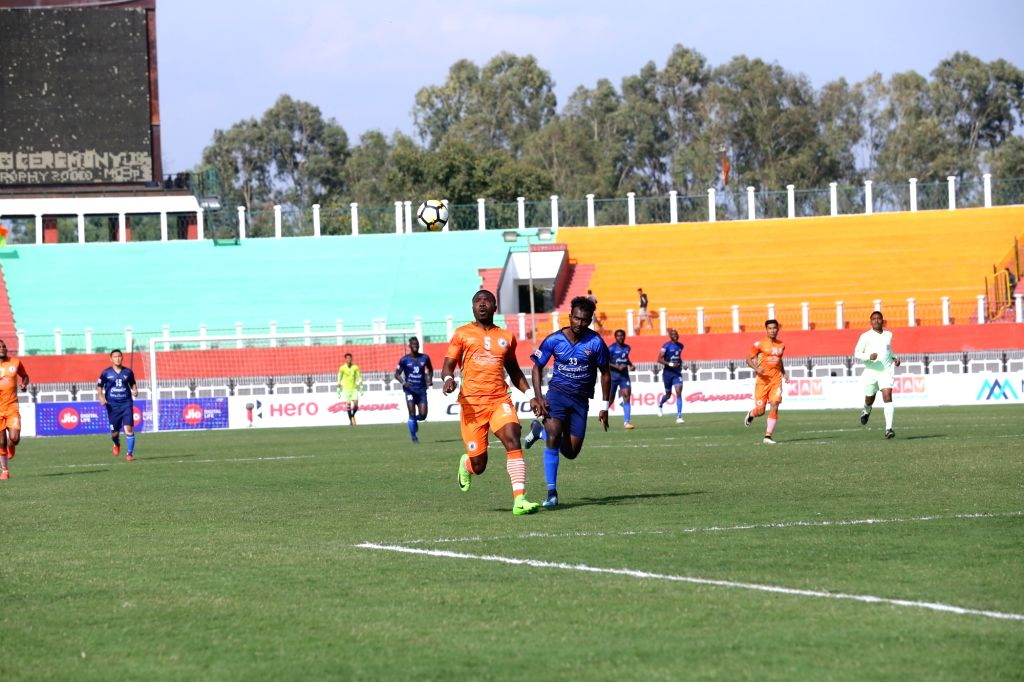 Players in action during an I-League match between Neroca FC and Churchill Brothers S.C. at the Khuman Lampak Stadium in Imphal on Feb 14, 201`8. An 86th-minute strike by Aryn Williams sealed ...