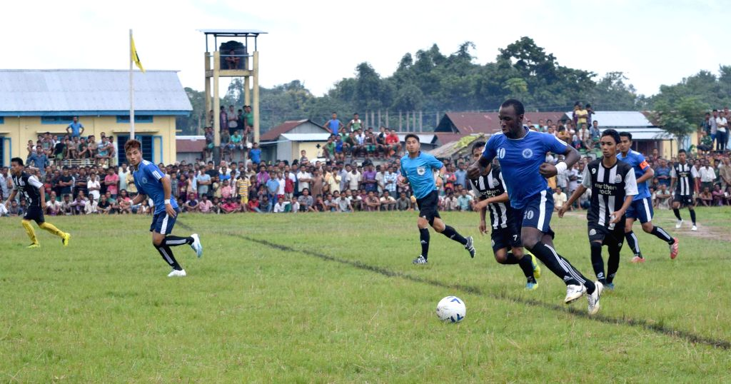 Players in action during an inaugural match of 4th Martyr's Joseph Basumatary Memorial Football Trophy between Gossaigaon Saalbagan Sports Club and  Sanswrang Football Club at Raimona Field, ...