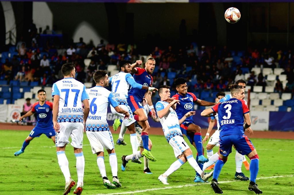 Players in action during an Indian Super League (ISL) 2019 match between Bengaluru FC and Jamshedpur FC at the Kanteerava Stadium in Bengaluru on Jan 9, 2020. Bengaluru FC reduced the gap ...