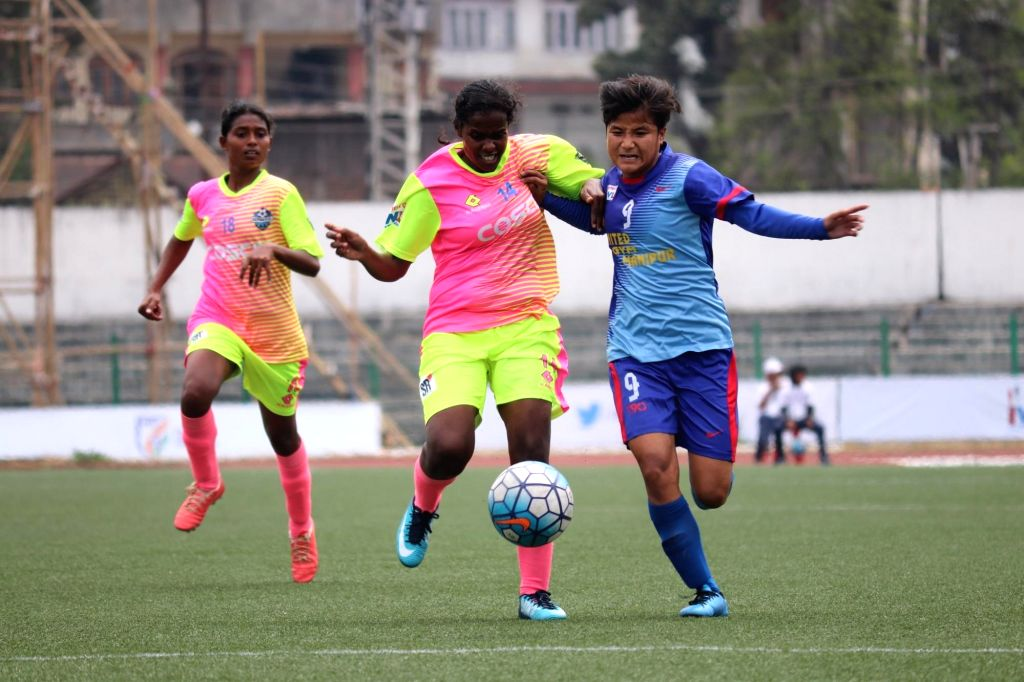 Players in action during an Indian Women's League match between KRYHPSA (Kangchup Road Young Physical and Sports Association) and Sethu FC, at the Jawaharlal Nehru Stadium in Shillong on ...