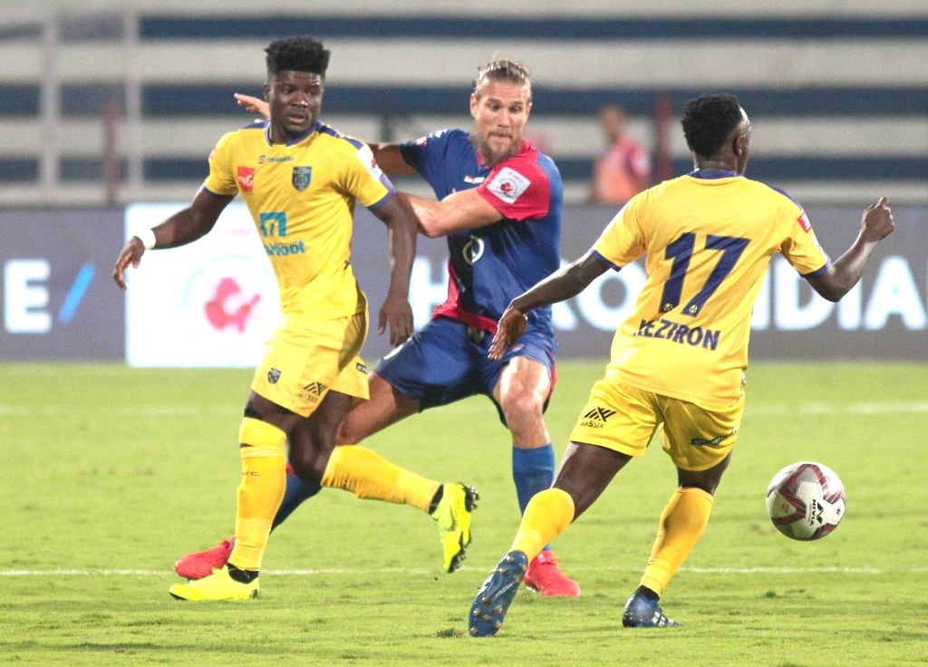 Players in action during an ISL 2018-19 match between BFC and Kerala Blasters FC at Kanteerava Stadium in Bengaluru on Feb 6, 2019.