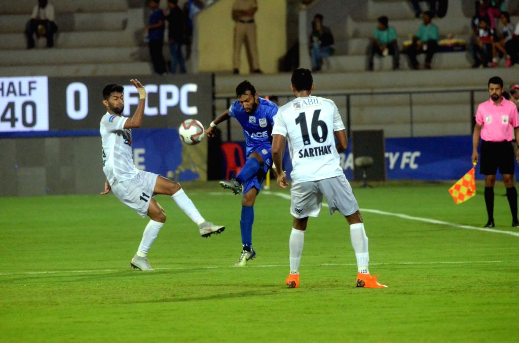 Players in action during an ISL 2018 match between Mumbai City FC and FC Pune City in Mumbai on Oct 19, 2018.