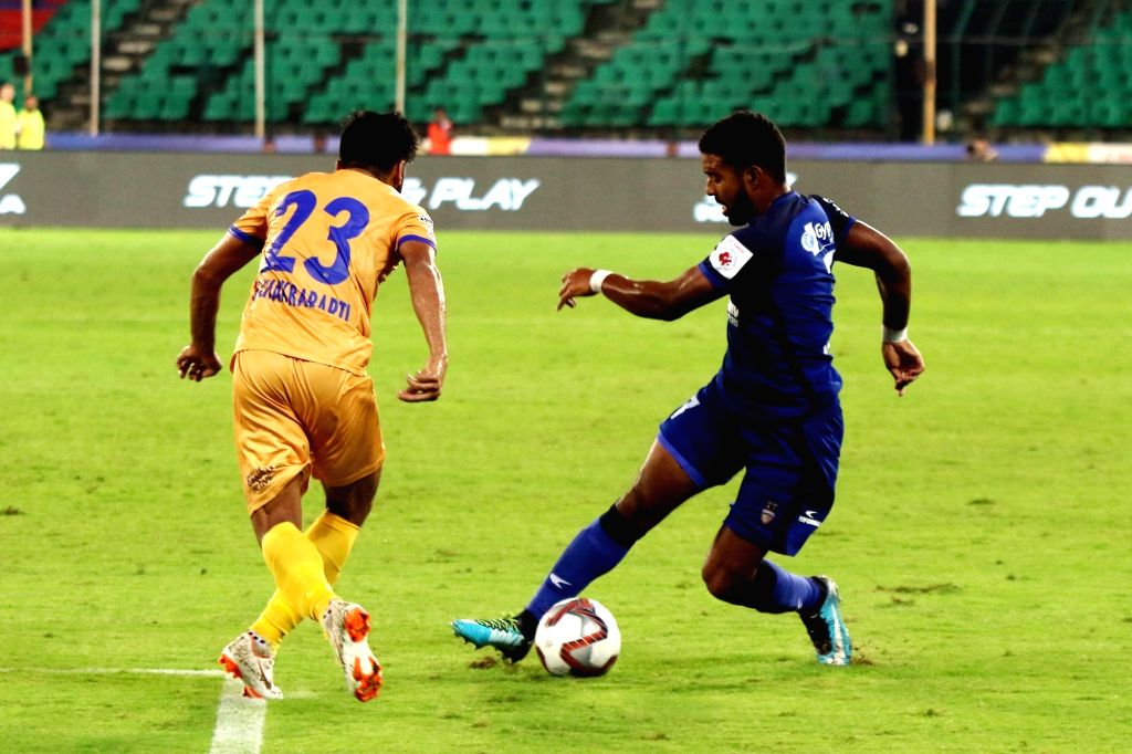Players in action during an ISL 2018 match between Chennaiyin FC and Mumbai City FC in Chennai on Nov 3, 2018.