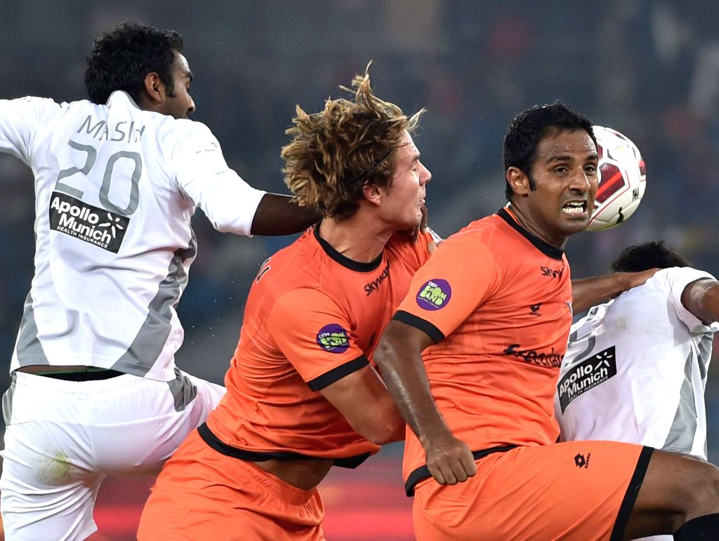 Players in action during an ISL match between Delhi Dynamos FC and Atletico de Kolkata at Jawaharlal Nehru Stadium in New Delhi, on Dec 2, 2014.