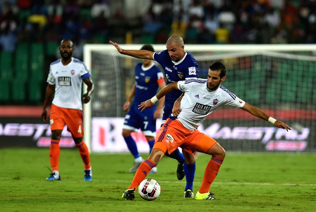 Players in action during an ISL match between Chennaiyan FC and FC Pune City at Jawaharlal Nehru Stadium in Chennai on Oct 24, 2015.