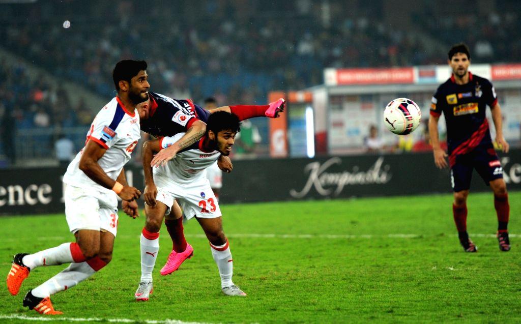 Players in action during an ISL match between Delhi Dynamos Football Club and Atletico de Kolkata in New Delhi on Nov 14, 2015.