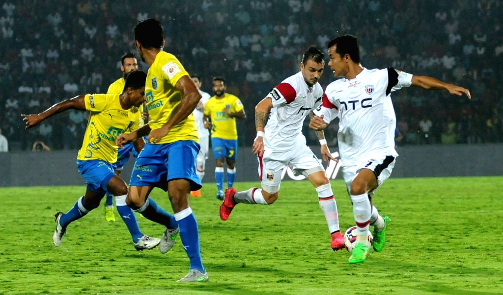 Players in action during an ISL match between North-East United FC and Kerala Blasters FC in Guwahati on Nov 15, 2015.
