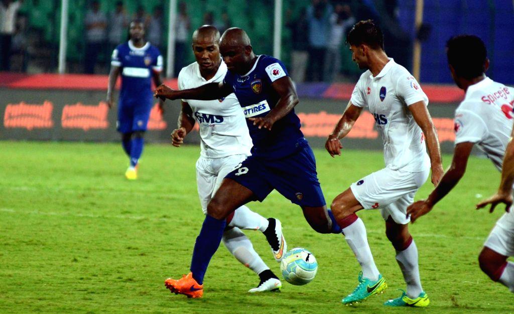 Players in action during an ISL match between Chennaiyin FC and Delhi Dynamos FCin Chennai on Oct 6, 2016.