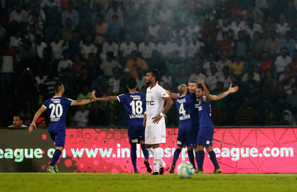 Players in action during an ISL match between NorthEast United FC and Chennaiyin FC in Guwahati on Oct 20, 2016.