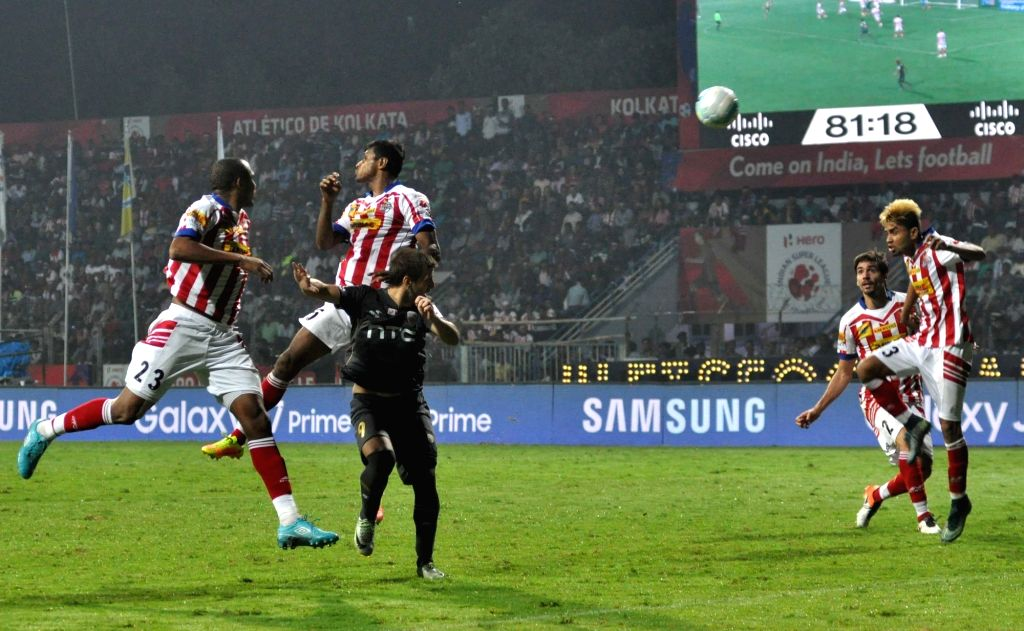 Players in action during an ISL match between Atletico de Kolkata and NorthEast United FC in Kolkata on Nov 17, 2016.