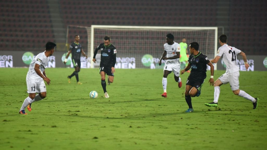 Players in action during an ISL match between NorthEast United FC and Delhi Dynamos FC at Indira Gandhi Athletics Stadium in Guwahati on Feb 14, 2018.