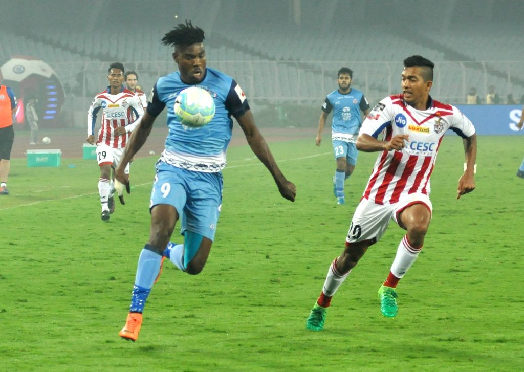 Players in action during an ISL match between ATK and Jamshedpur FC at Salt Lake Stadium in Kolkata, on Jan 28, 2018.