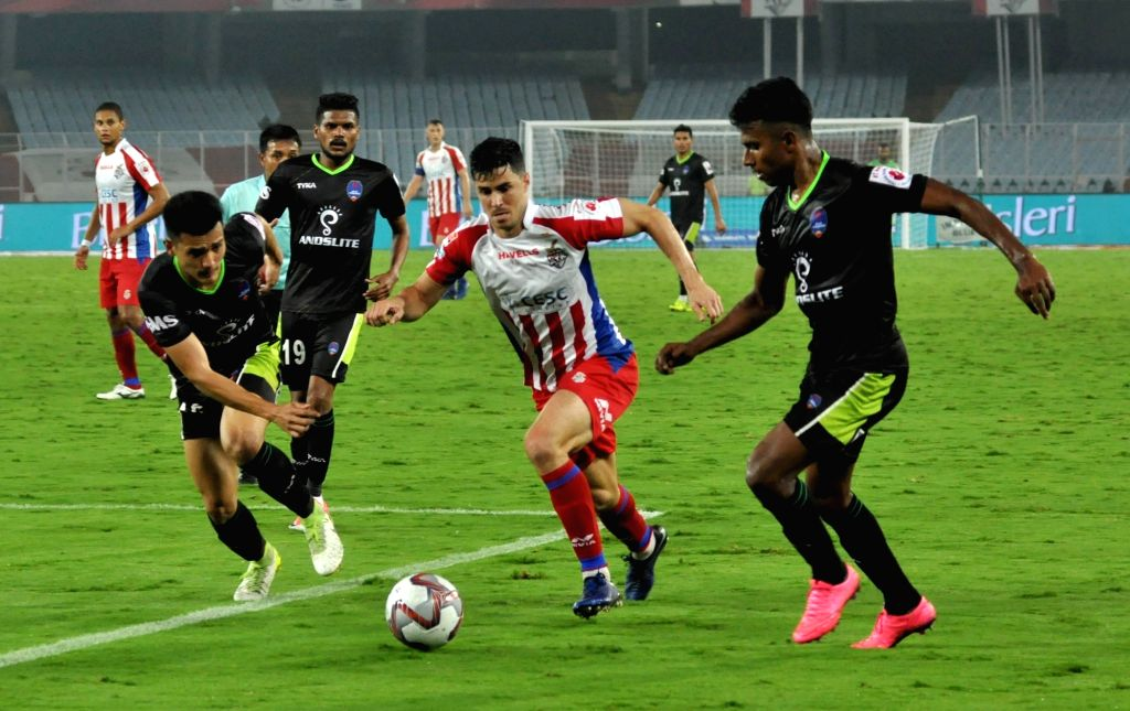 Players in action during an ISL match between ATK and Delhi Dynamos FC at Salt Lake Stadium in Kolkata on March 3, 2019.