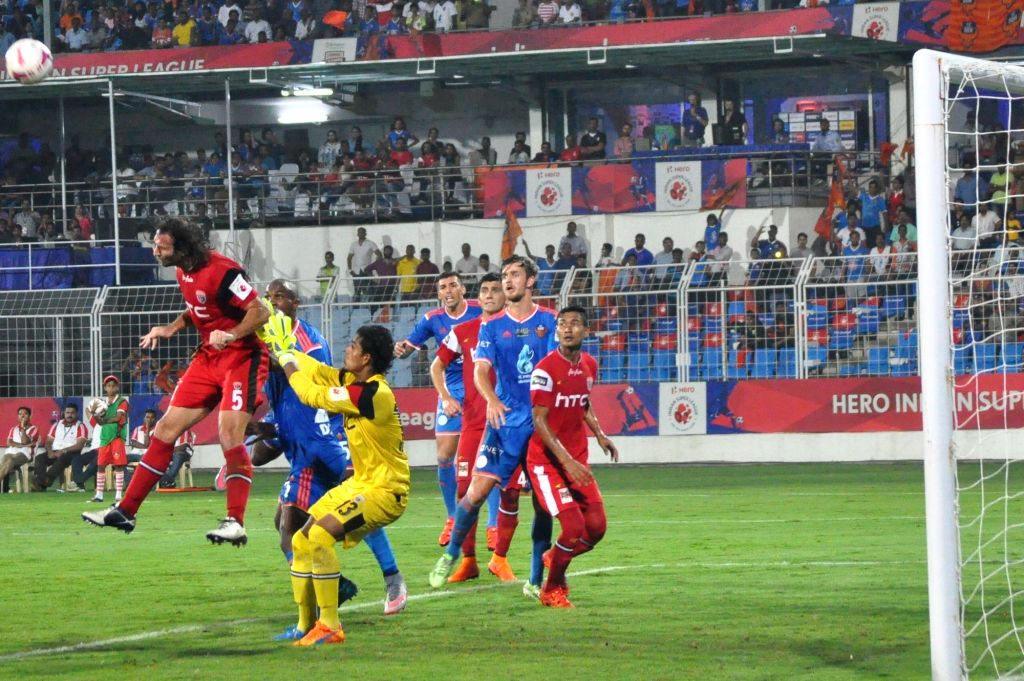 Players in action during an ISL match between  FC Goa and NorthEast United FC at Jawaharlal Nehru Stadium in Fatorda, Goa on Nov 25, 2015.