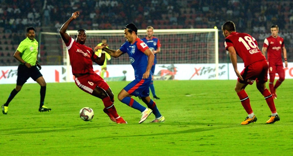 Players in action during an ISL semi-final match between North East United FC and Bengaluru FC at Indira Gandhi Athletics Stadium, in Guwahati on March 7, 2019.