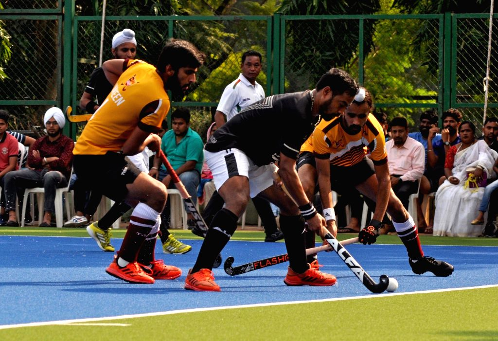 Players in action during Beighton Cup match between Indian Oil Corporation Ltd and Punjab National Bank at SAI complex, in Kolkata on Nov 11, 2019. Indian Oil Corporation Ltd won the ...