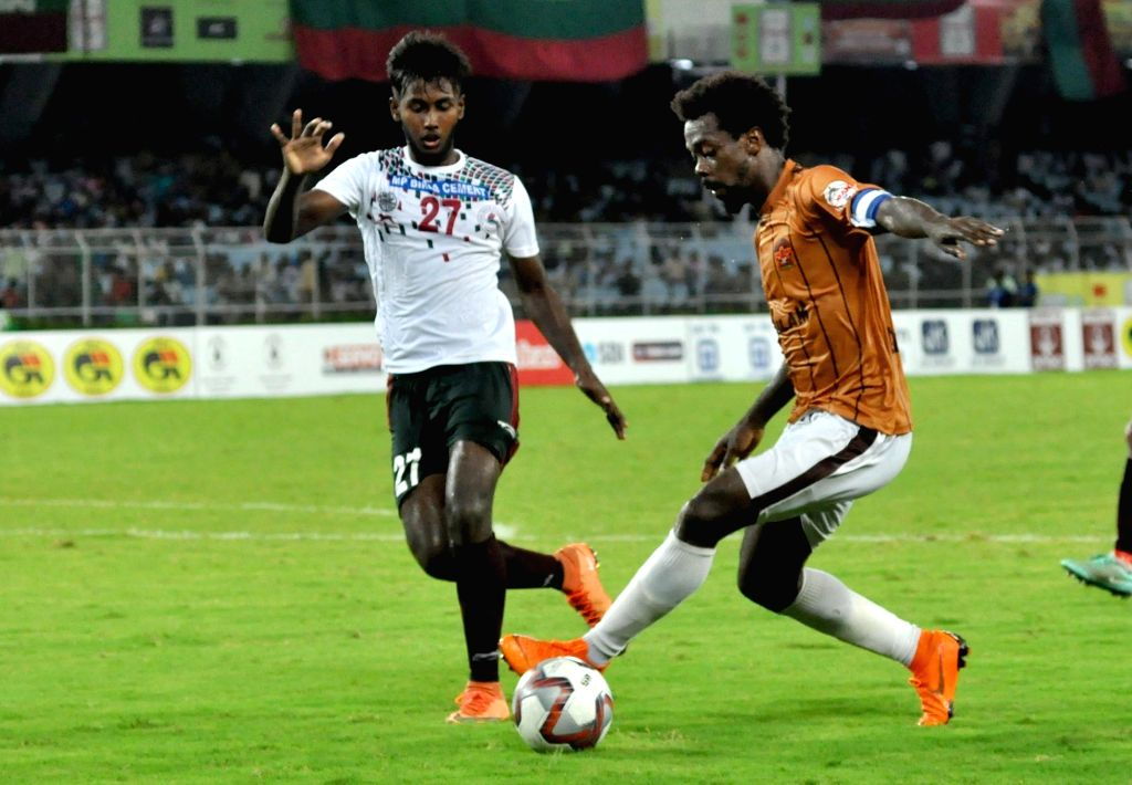 Players in action during Durand Cup Final match between Mohun Bagan A.C. and Gokulam FC in Kolkata on Aug 24, 2019.