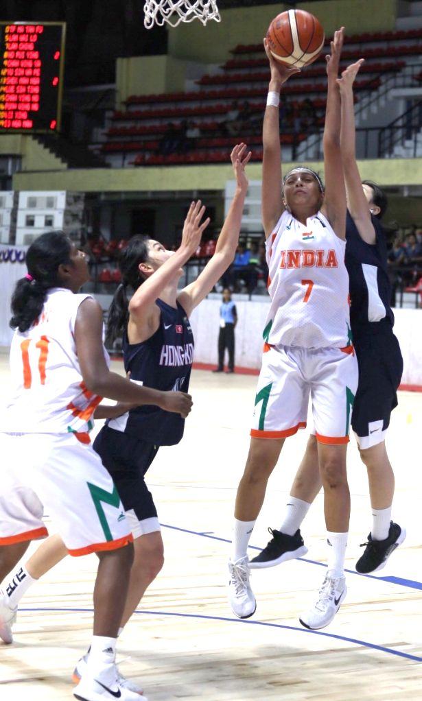 Players in action during FIBA U18 Women's Asian Championship Division - B semifinal match between India and Hong Kong at Kanteerava Stadium in Bengaluru, on Nov 2, 2018.