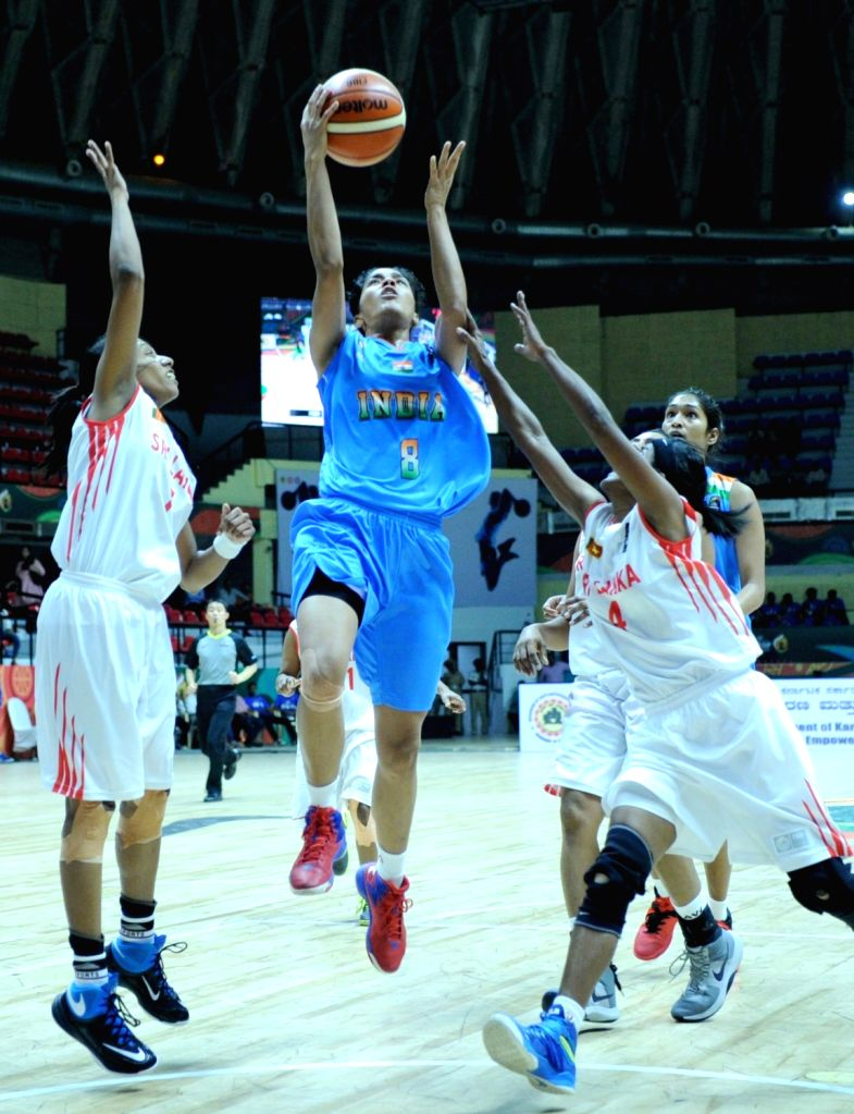 Players in action during FIBA Women's Asia Cup 2017 match between India and Sri Lanka at Kanteerava Stadium in Bengaluru on July 25, 2017.