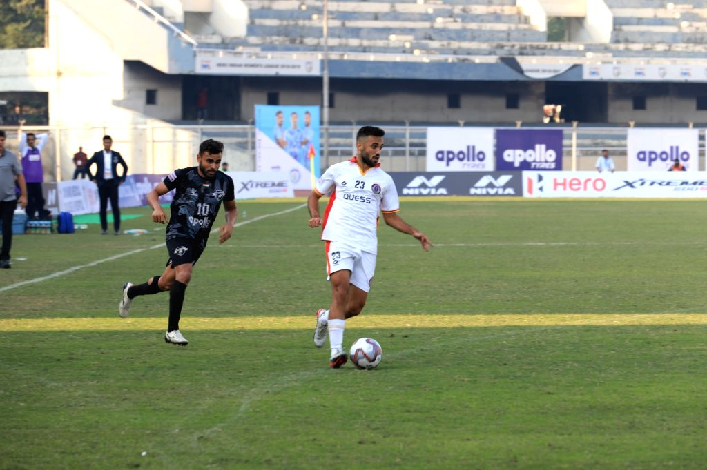 Players in action during Hero I-League match between Punjab FC and Quess East Bengal (QEB) at the Guru Nanak Stadium in Punjab's Ludhiana, on Dec 7, 2019. Punjab FC earned their first point ...