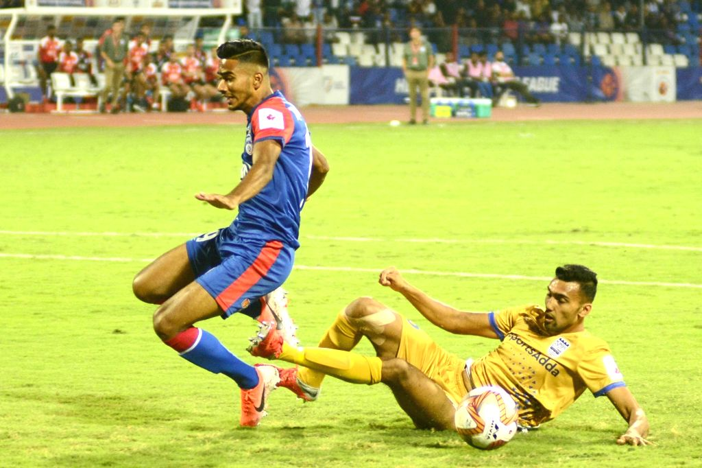 Players in action during Indian Super League (ISL) match between Bengaluru FC and Mumbai City FC at the Sree Kanteerava Stadium in Bengaluru on Dec 15, 2019.