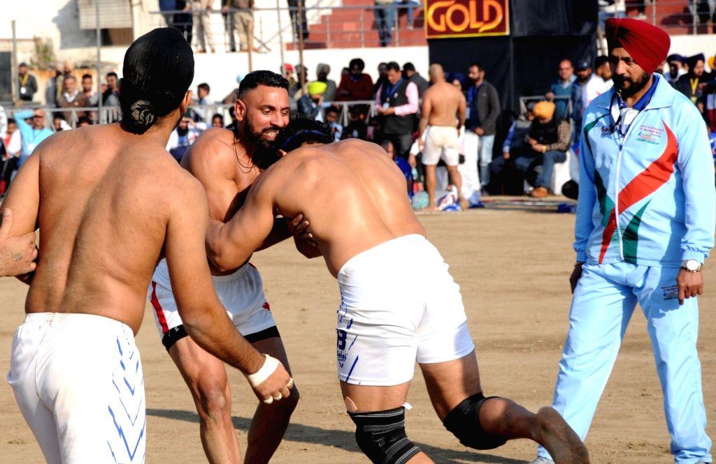 Players in action during International Kabaddi Tournament 2019 between Canada and USA, organised to mark the 550th Prakash Utsav of Guru Nanak Dev at Guru Nanak stadium in Amritsar, on Dec ... - Nanak Dev