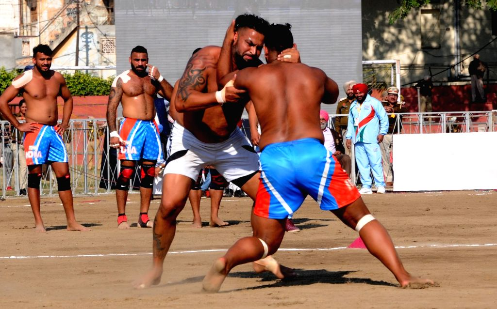 Players in action during International Kabaddi Tournament 2019 between India and England, organised to mark the 550th Prakash Utsav of Guru Nanak Dev at Guru Nanak stadium in Amritsar, on ... - Nanak Dev