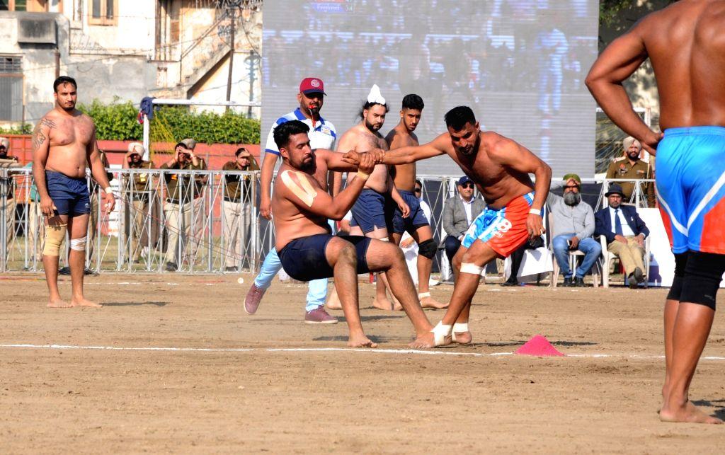 Players in action during International Kabaddi Tournament 2019 between India and England, organised to mark the 550th Prakash Utsav of Guru Nanak Dev at Guru Nanak stadium in Amritsar, on ... - Nanak Dev
