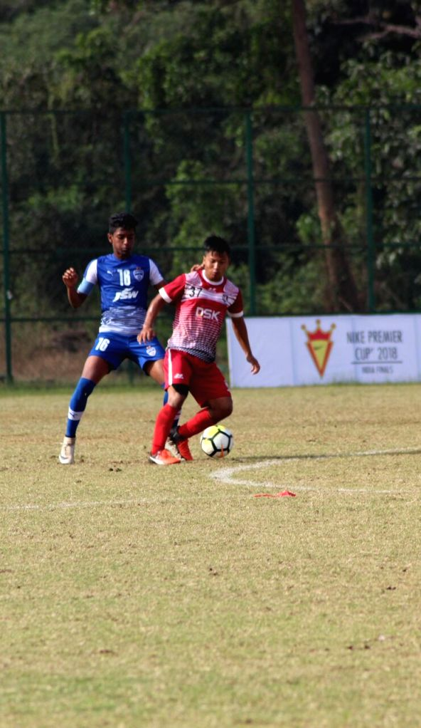 Players in action during Nike Premier Cup match between DSK Shivajians FC and Bengaluru FC at the Nagoa sports complex ground in Goa on Feb 6, 2018. Shivajians FC knocked out Bengaluru FC to ...