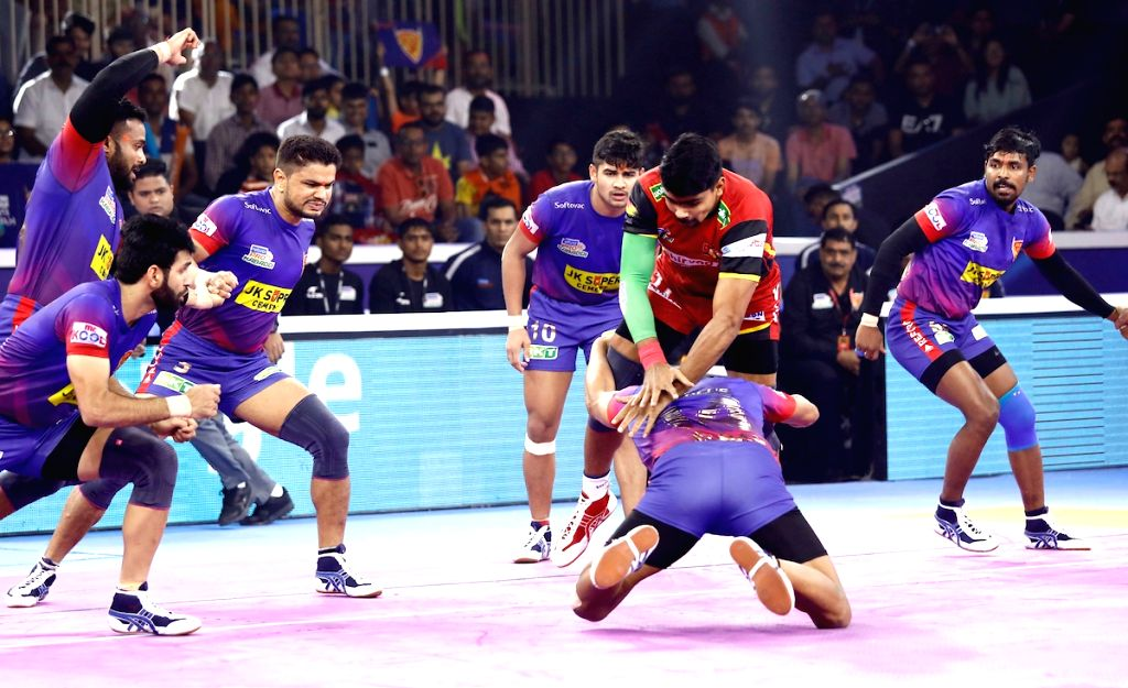 Players in action during Pro Kabaddi Season 7 1st Semi Final match between Dabang Delhi and Bengaluru Bulls at the EKA Arena by TransStadia in Ahmedabad on Oct 16, 2019.