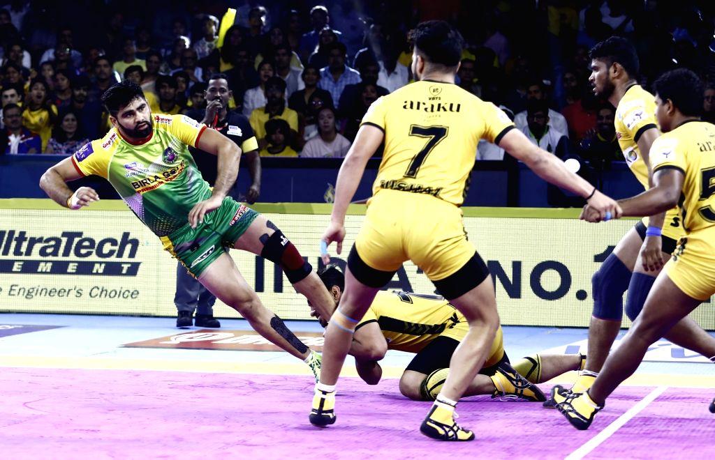 Players in action during Pro Kabaddi Season 7 match between Telugu Titans and Patna Pirates at Gachibowli Indoor Stadium in Hyderabad, on July 26, 2019.