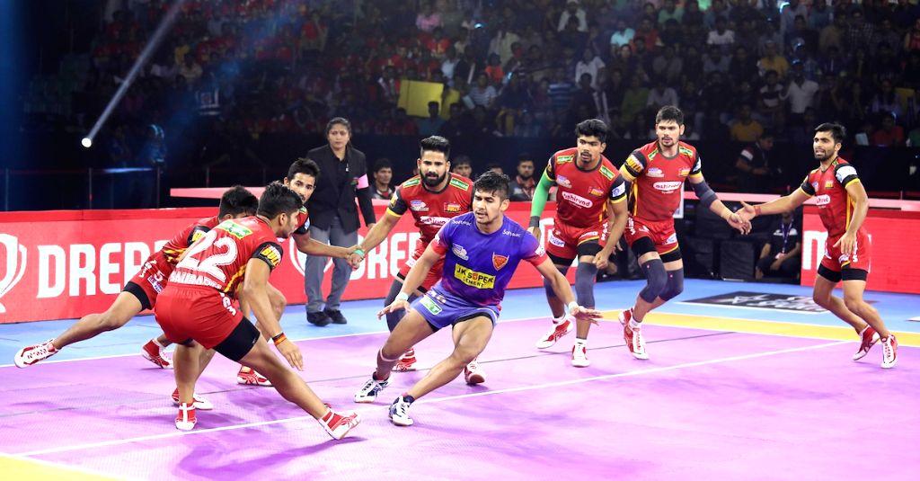 Players in action during Pro Kabaddi Season 7 match between Dabang Delhi K.C. and Bengaluru Bulls at Thayagraj Sports Complex in New Delhi on Aug 24, 2019.